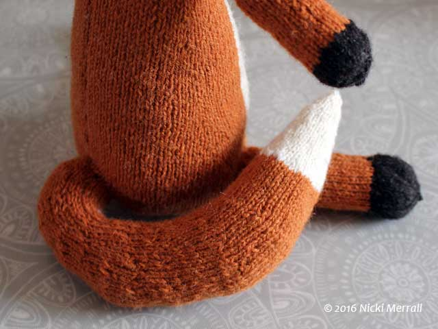 Close-up of tail of knitted fox