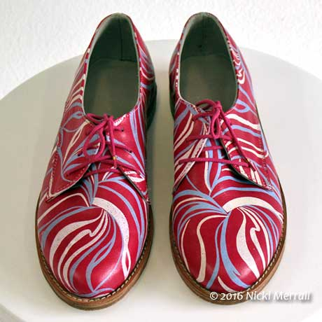 Pink shoes printed with a swirly pattern in pale colours