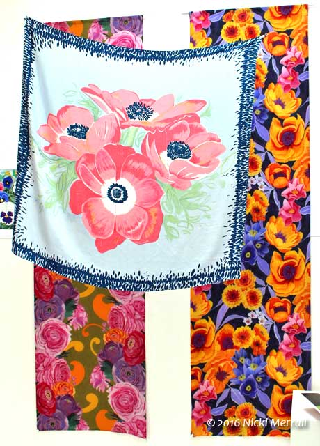 Floral scarf and lengths of printed fabrics