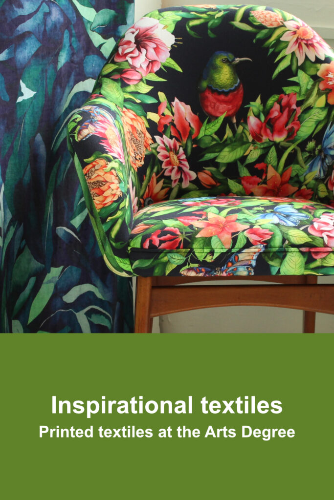 Floral printed fabric used to upholster an armchair with coordinating wallpaper behind it