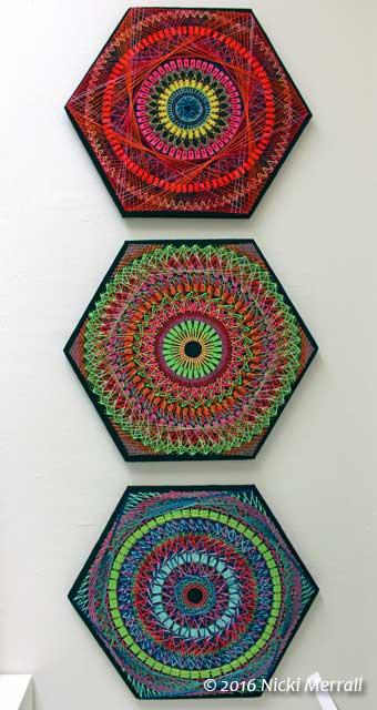 Three hexagonal multi-media textile pieces