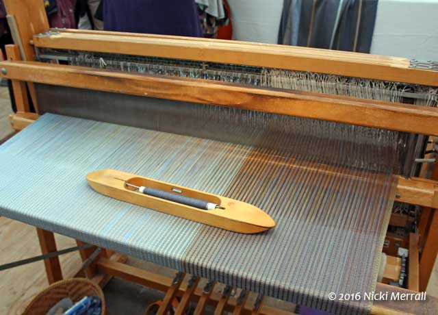 Loom and shuttle ready to weave
