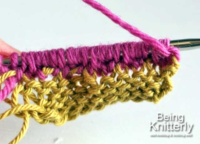 Step 10: Carry on purling two stitches and knitting two purl bumps to end of row