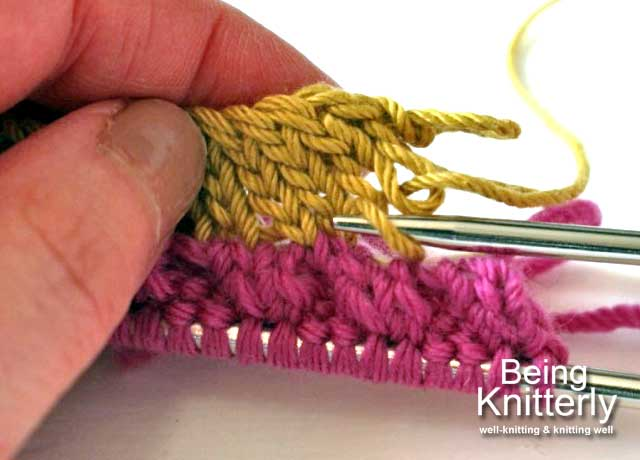 Step 12: Use knitting needle to remove waste yarn one stitch at a time