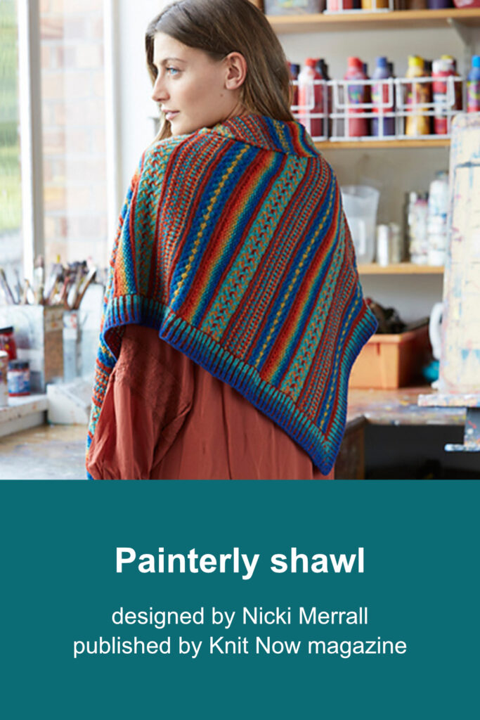 Woman wearing asymmetric triangular shawl worked from single point to shortest edge by increasing along one side. Two shorter sides are finished with brioche rib