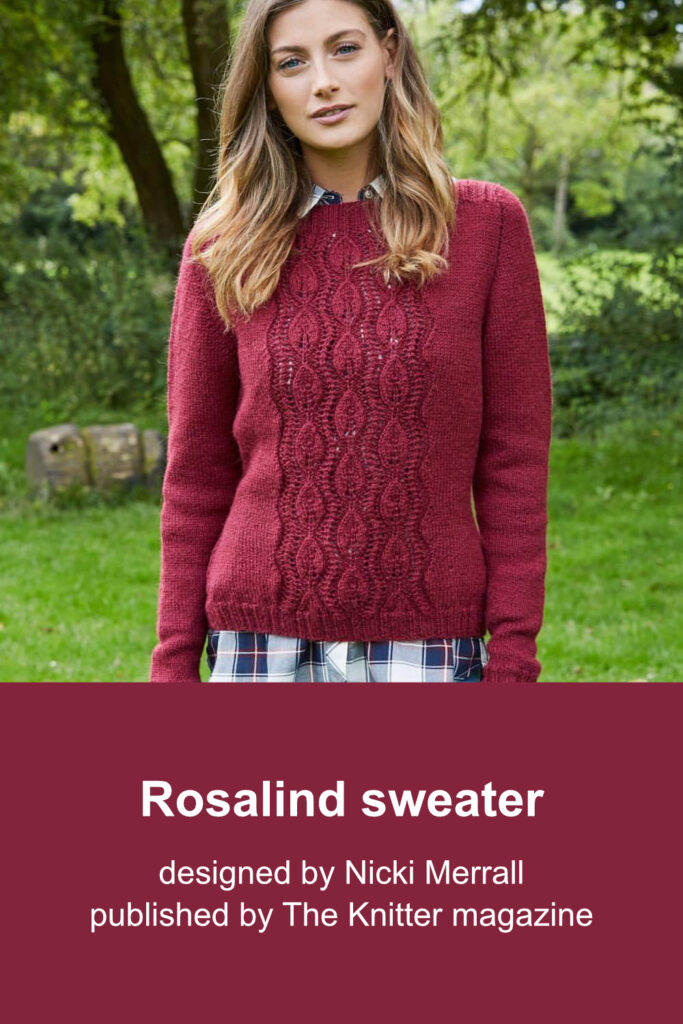 Burgundy fitted hand-knit sweater featuring lace panel with leaf motifs on the front.
