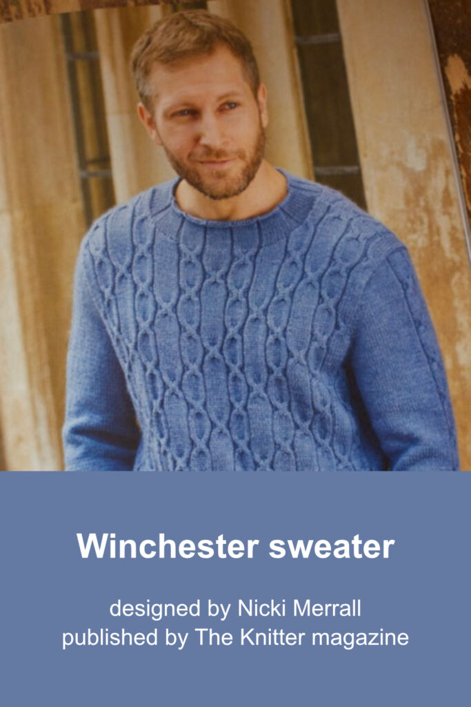 Blue wool hand-knit sweater with all-over cable pattern on the front and narrow cable pattern on the sleeve.