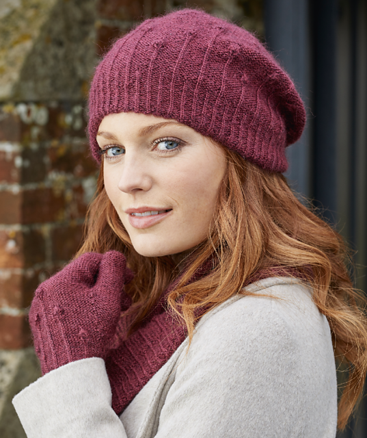 Burgundy wool hand-knit Seed Heads hat, cowl and gloves feature stitch pattern inspired by poppy seed heads