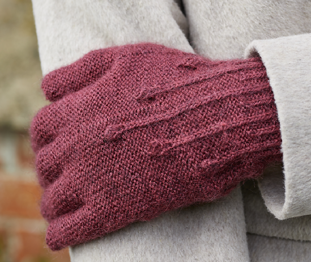 Burgundy wool hand-knit Seed Heads gloves feature stitch pattern inspired by poppy seed heads