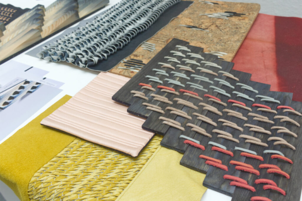 Display of multi-media textiles by Becky Henning-Lee