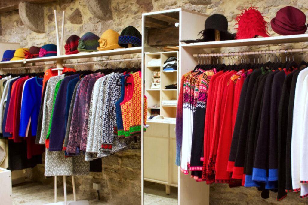 Interior of one Estonian handicraft centre showing rail of traditional Estonian knitwear