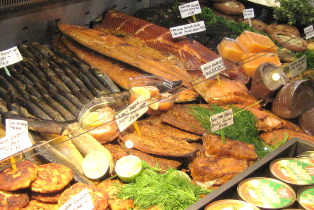 Market stall with display of many different smoked fish products