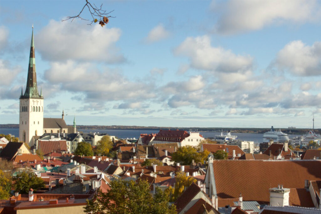 View of roof tops and church in Tallinn Old Town and the port beyond