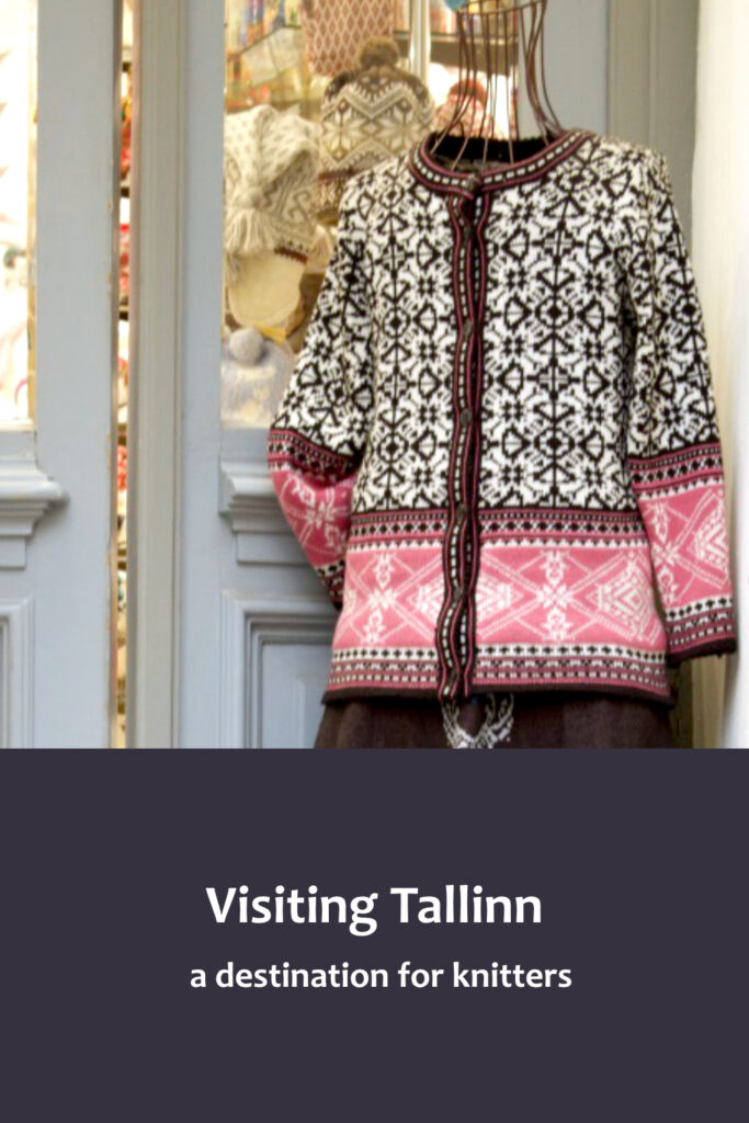 Traditional Estonian women's clothing displayed on wickerwork mannequin in entrance of shop in Old Town, Tallinn. Mannequin is wearing black skirt, with deep embroidered border in blue and white, and cardigan knitted in black and white geometric pattern with deep borders, on the body and sleeves, in medium pink and white