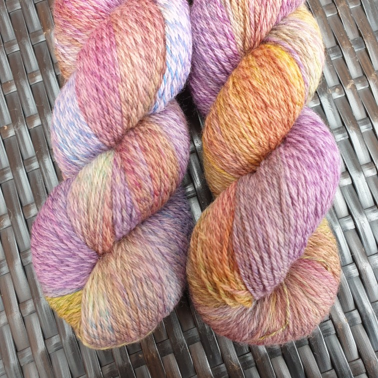 Two skeins of hand-dyed yarn from Burrow & Soar