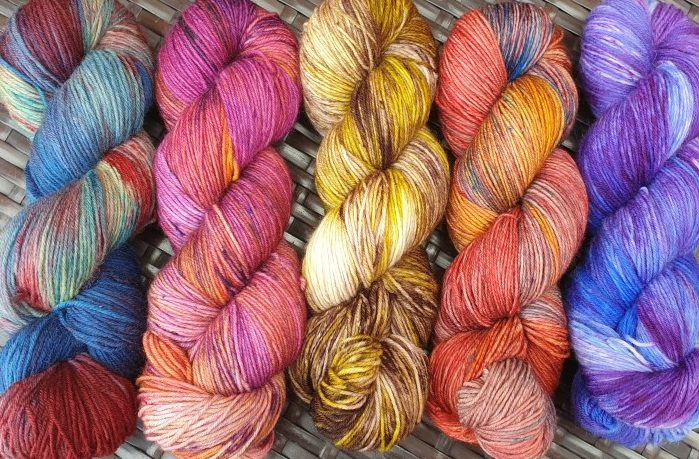 Five hanks of hand-dyed yarn from Burrow and Soar