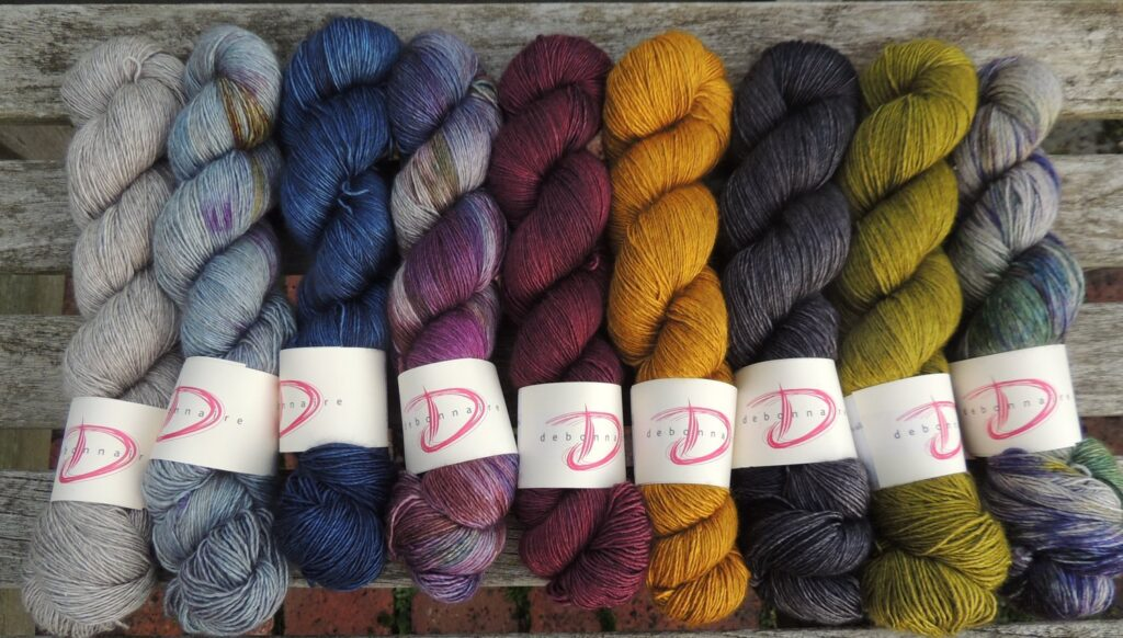 Nine hanks of hand-dyed yarn from Debonnaire Yarns