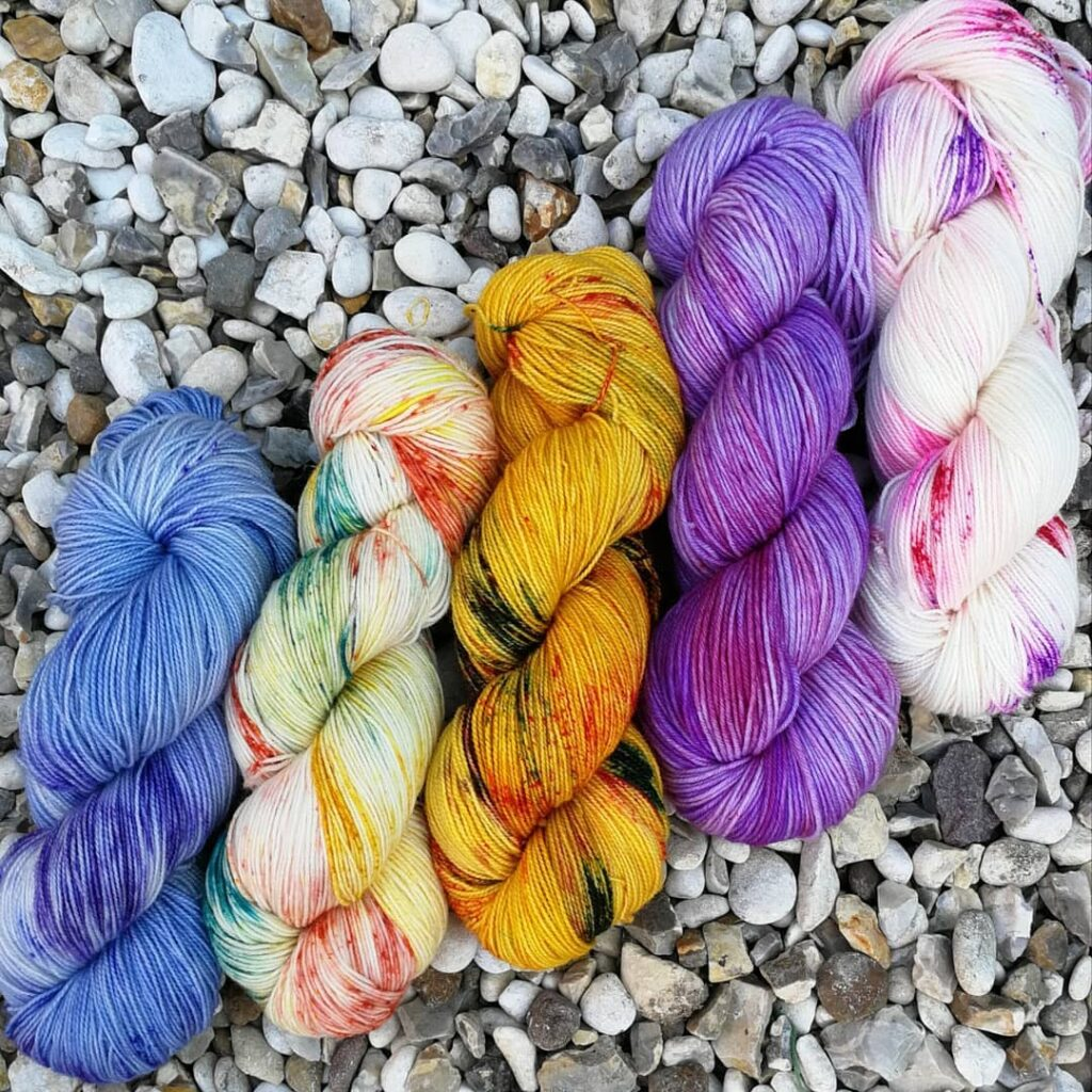 Five hanks of hand-dyed yarn from Hummingbird Yarns