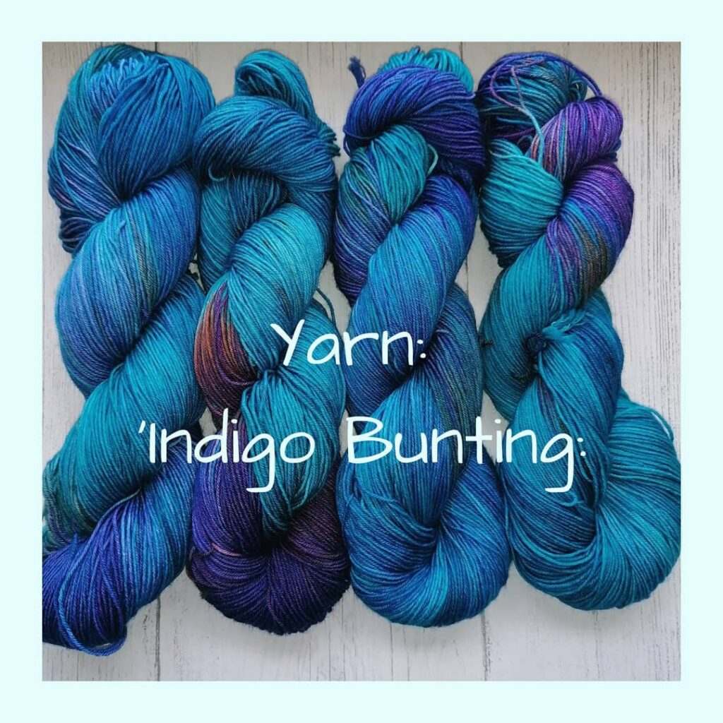 Four hanks of hand-dyed yarn from Hummingbird Yarns