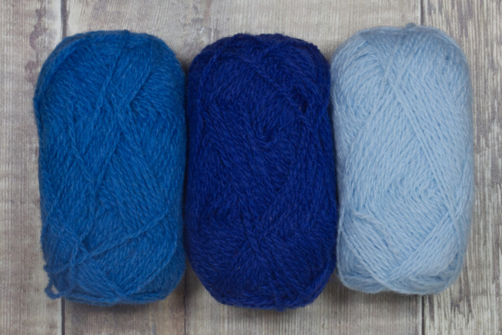 Suggested colour palette for Tesserae fingerless mittens: Lunar, Cobalt and Cloud in Shetland Spindrift.