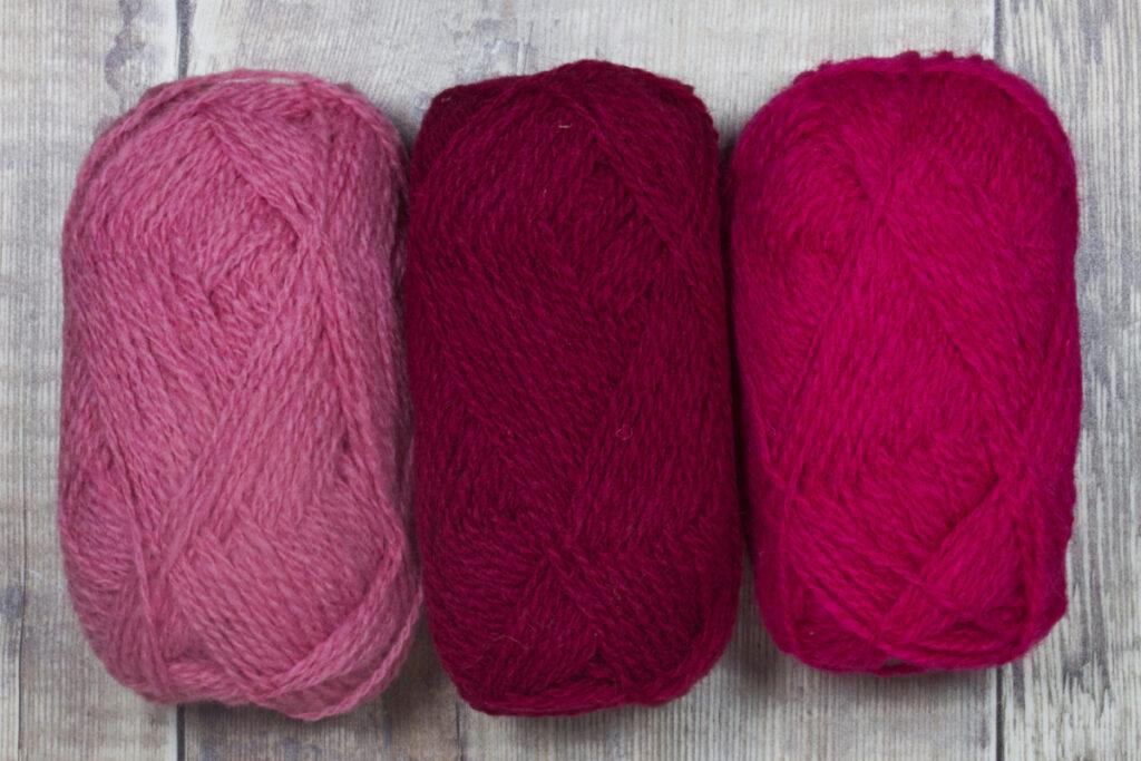Suggested colour palette for Tesserae fingerless mittens: Sorbet, Cherry and Plum in Shetland Spindrift