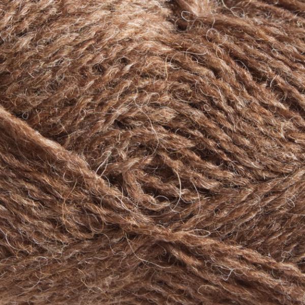 Close-up of a ball of Shetland Spindrift yarn in 0108 Moorit.