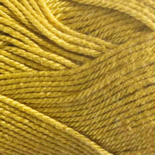 Close up of Quattro cotton yarn in shade 011 Yellow Ochre.