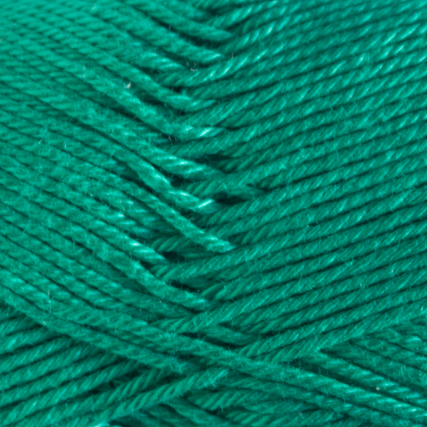 Close up of Quattro cotton yarn in shade 017 Emerald Green.