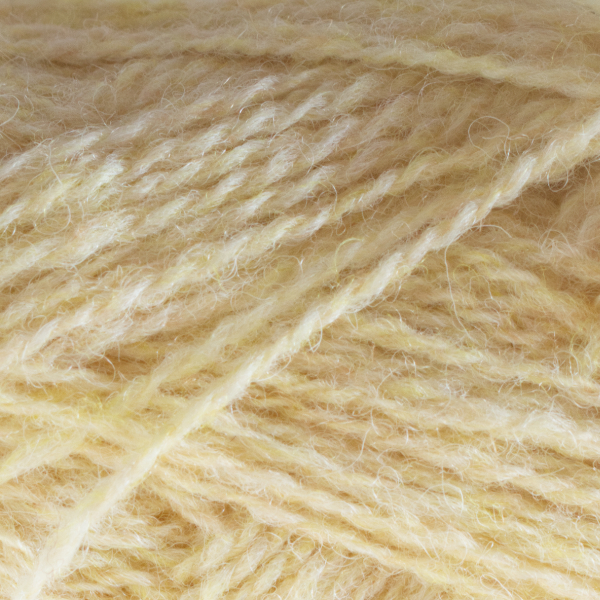 Close-up of a ball of Shetland Spindrift yarn in 0179 Buttermilk.