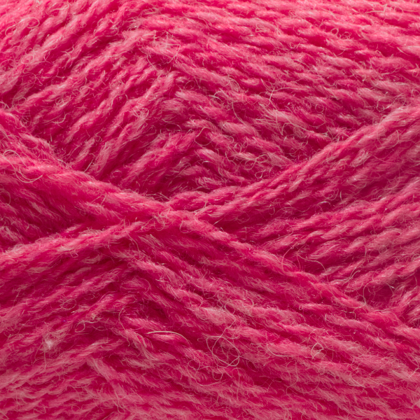Close-up of a ball of Shetland Spindrift yarn in 0188 Sherbet.