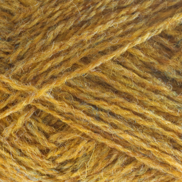Close-up of a ball of Shetland Spindrift yarn in 0230 Yellow Ochre.