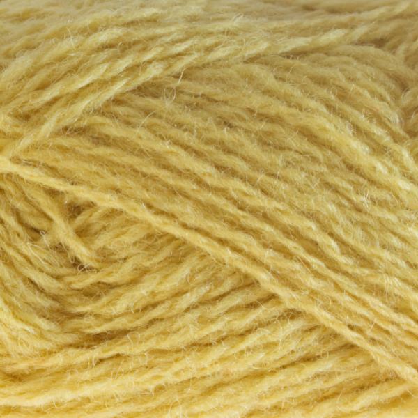 Close-up of a ball of Shetland Spindrift yarn in 0390 Daffodil.