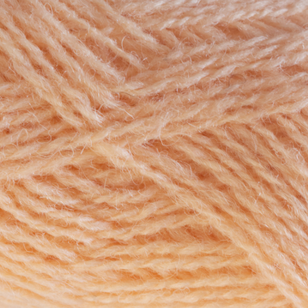 Close-up of a ball of Shetland Spindrift yarn in 0435 Apricot.