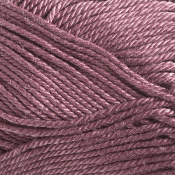 Close up of Quattro cotton yarn in shade 048 Dusty Rose.