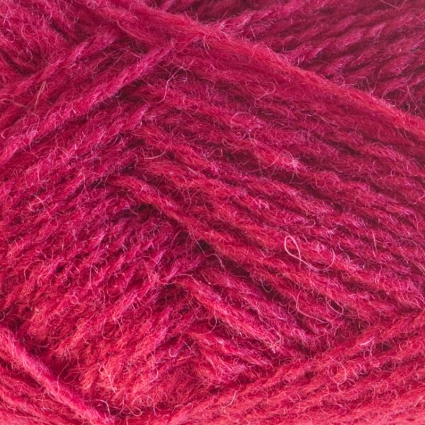 Close-up of a ball of Shetland Spindrift yarn in 0580 Cherry.
