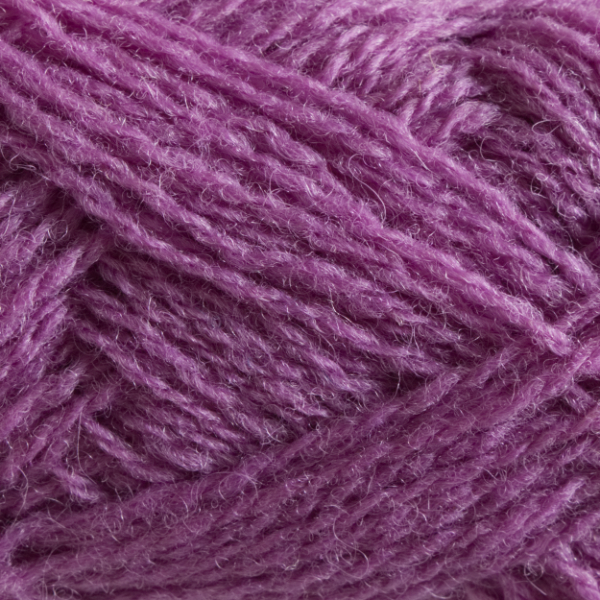 Close-up of a ball of Shetland Spindrift yarn in 0616 Anemone.