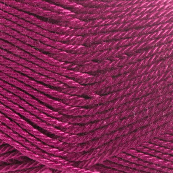 Close up of Quattro cotton yarn in shade 066 Burgundy.