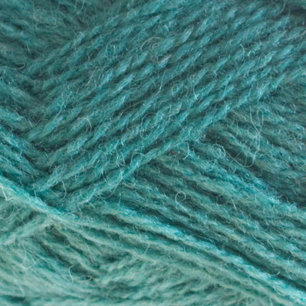 Close-up of a ball of Shetland Spindrift yarn in 0772 Verdigris.