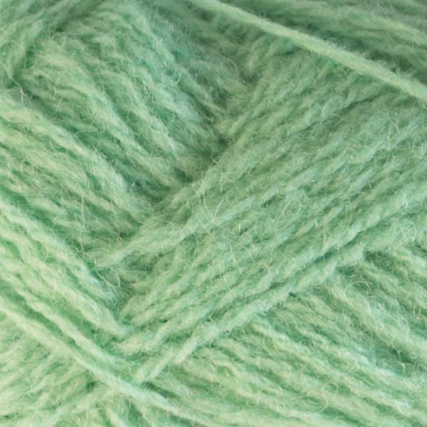Close-up of a ball of Shetland Spindrift yarn in 0785 Apple.