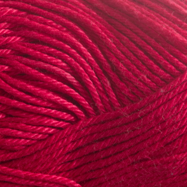 Close up of Quattro cotton yarn in shade 087 Deep Red.