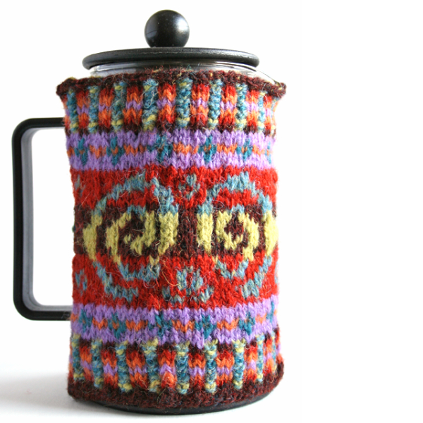 Colourful hand-knitted Fair Isle style cafetière cosy with corrugated rib, simple borders and main pattern based on doodle