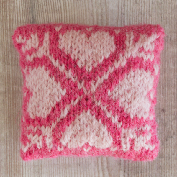 Fair Isle style lavender bag with four pale pink hearts on bright pink background