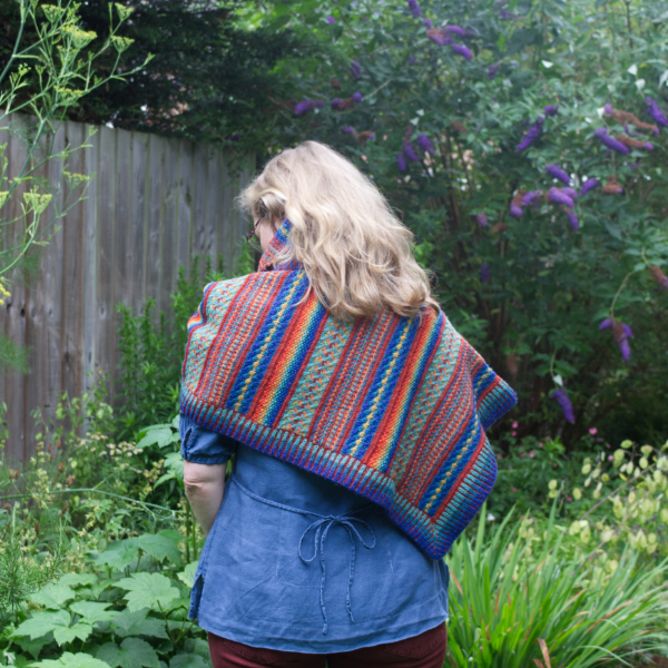 Colourful asymmetric triangular shawl with brioche stitch border