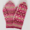 Hand-knitted Fair Isle style mittens in shades of pink with large flower motif on back and small patterns on palm and thumbs