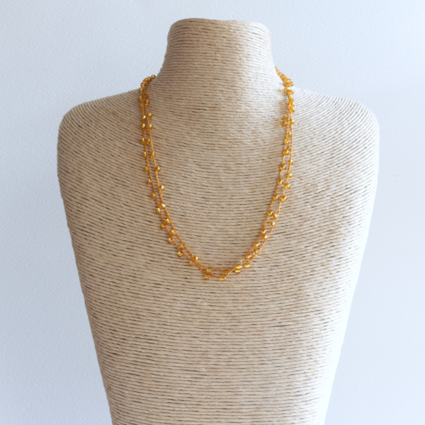 Gold sparkly crochet necklace made using fine thread and beads