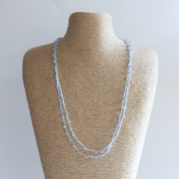 Pale blue sparkly crochet necklace made using fine thread and beads