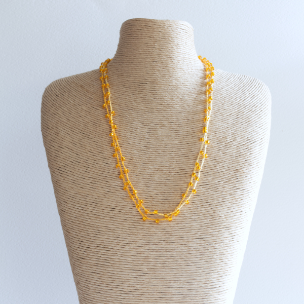Orange sparkly crochet necklace made using fine thread and beads