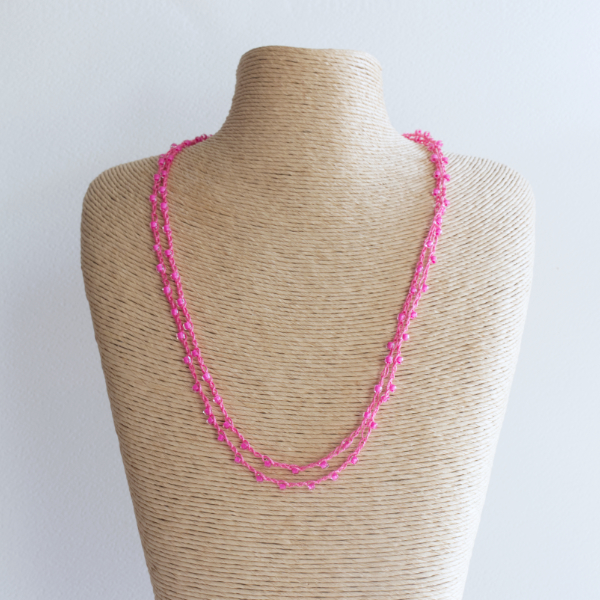 Pink sparkly crochet necklace made using fine thread and beads