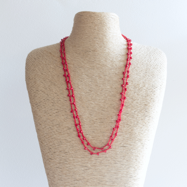Red sparkly crochet necklace made using fine thread and beads