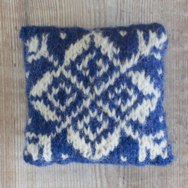 Fair Isle style lavender bag with white star on royal blue background